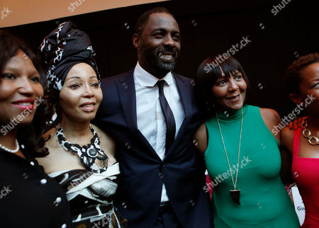 Idris Elba British actor Idris Elba, second from right, who stars as Nelson Mandela, poses with Ndleka Mandela, grand daughter of former president Nelson Mandela, right, and Sazizwe Dlamini Manaway, left, grand daughter of Mandela, and wife of justice minister Jeff Radebe Brigette Radebe, second from left, at the South African premier of the film Mandela - Long Walk To Freedom, in Johannesburg. The biographical film directed by Justin Chadwick, is based on South African President Nelson Mandela's autobiography of the same name, which chronicles his early life, coming of age, education and 27 years in prison before becoming President and working to rebuild the country's once segregated society