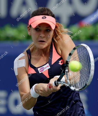 Agnieszka Radwanska Agnieszka Radwanska of Poland returns a shot against Vera Dushevina of Russia during the quarterfinal match of the Korea Open tennis championships in Seoul, South Korea