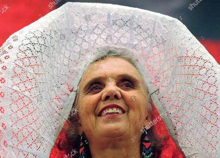 """Elena Poniatowska Mexican author Elena Poniatowska, wearing a traditional tehuana outfit, smiles during the presentation of her new book """"El Tren Paso Primero"""", """"The Train Passed First"""", during the 19th Guadalajara International Book Fair in Guadalajara City, Mexico. Poniatowska has won the 2013 Cervantes Prize, the Spanish-speaking world's highest literary honor it was announced on . The euro 125,000 prize generally alternates between Spanish and Latin American writers. Previous winners include Carlos Fuentes of Mexico, and Nobel prize winners Mario Vargas Llosa of Peru and Spain's late Camilo Jose Cela. They are presented each April 23, the anniversary of the death of Miguel de Cervantes, author of """"Don Quijote"""