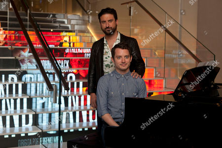 Eugenio Mira, Elijah Wood Spanish director Eugenio Mira stands next to U.S. actor Elijah Wood sitting in front of the piano attends 'Grand Piano' photocall at the Telefonica Store Gran Via in Madrid, Spain