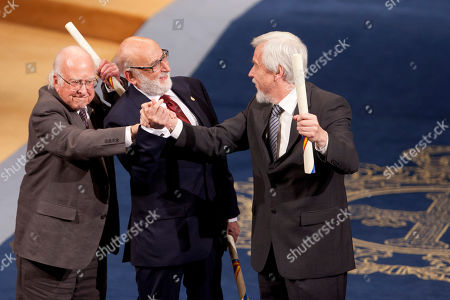 Peter Higgs, François Englert, Rolf Heuer Nobel Prize laureates, British theoretical physicist, Peter Higgs, left, Belgian theoretical physicist François Englert, center, react with German particle physicist Rolf Heuer, right, after receiving the 2013 Prince of Asturias award for Technical and Scientific Research at a ceremony in Oviedo, northern Spain