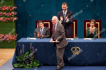Peter Higgs, François Englert, Rolf Heuer Nobel Prize laureates, British theoretical physicist, reacts, after receiving the 2013 Prince of Asturias award for Technical and Scientific Research at a ceremony in Oviedo, northern Spain