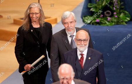 U.S. photographer Annie Leibovitz, left, German Director General of CERN Rolf Heuer, center, and Belgian theoretical physicist François Englert, right, during the Prince of Asturias Prize ceremony at Campoamor Theatre in Oviedo, northern Spain