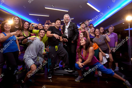 Beto Perez, Richard Branson Colombian choreographer Beto Perez, centre left, and Richard Branson pose with dancers during a visit to a Zumba Step dance class at Virgin installations in Madrid, Spain
