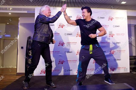 Richard Branson, Beto Perez Sir Richard Branson, left, and Colombian choreographer Beto Perez dance during a visit to a Zumba Step dance class at Virgin installations in Madrid, Spain