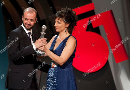 Fernando Franco, Mariela Besuievsky Spanish film director Fernando Franco, left, gestures after received the Special Jury Prize with the film ''La Herida'' (Wounded) by Official Jury member, Mariela Besuievsky, for the 61st San Sebastian Film Festival, in San Sebastian, northern Spain