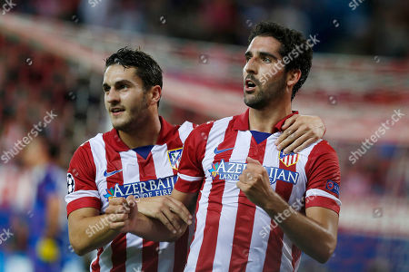"Raul Garcia, Jorge Merodio ""Koke Atletico Madrid's Raul Garcia, right, celebrates his goal with Jorge Resurreccion ""Koke"", left, during a Champions League Group G soccer match between Atletico Madrid and Austria Vienna, at the Vicente Calderon stadium in Madrid"