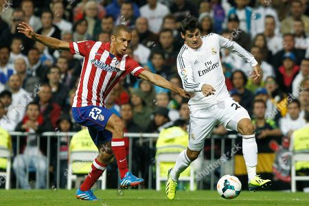 Alvaro Morata, Joao Miranda Real Madrid's Alvaro Morata, right, vies for the ball with Atletico de Madrid's Joao Miranda from Brazil during a Spanish La Liga soccer match at the Santiago Bernabeu stadium in Madrid, Spain