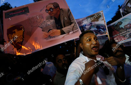 Sri Lankan people protest against British Channel 4's documentary producer of No Fire Zone and Killing Fields, Callum Macrae outside a hotel where he stays following his arrival to attend the Commonwealth Heads of Government Meeting (CHOGM) in Colombo, Sri Lanka, . Sri Lanka will host the 22nd CHOGM Nov 15- 17 in Colombo