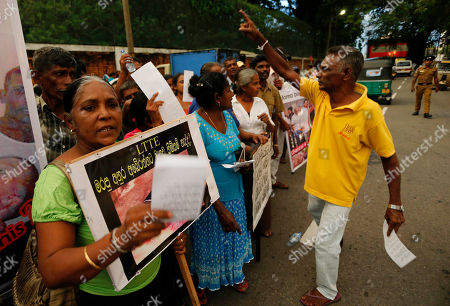 "Stock Image of Sri Lankan people protest against British Channel 4's documentary producer of No Fire Zone and Killing Fields, Callum Macrae outside a hotel where he stays following his arrival to attend the Commonwealth Heads of Government Meeting (CHOGM) in Colombo, Sri Lanka, . Placard in Sinhalese reads, ""Aren't there any human rights for the victims of LTTE"". Sri Lanka will host the 22nd CHOGM Nov 15- 17 in Colombo"