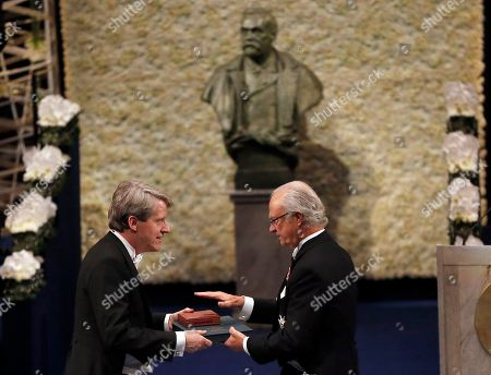 The 2013 Nobel Prize Laureate in Economic Sciences Robert J. Shiller of the US receives his Nobel Prize from Sweden's King Carl XVI Gustaf, during the Nobel Prize award ceremony at the Stockholm Concert Hall in Stockholm, . The Nobel awards are always awarded on Dec. 10, the anniversary of Alfred Nobel's death in 1896. The prizes for laureates in medicine, chemistry, physics, economics and literature are awarded in the Swedish capital Stockholm, whilst the Nobel Peace Prize is awarded on the same day in Oslo, Norway