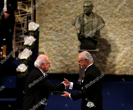 Stock Image of The 2013 Nobel Prize Laureate in Physics, Britain's Peter Higgs, receives his Nobel Prize from Sweden's King Carl XVI Gustaf, during the Nobel Prize award ceremony at the Stockholm Concert Hall in Stockholm, . The Nobel awards are always awarded on Dec. 10, the anniversary of Alfred Nobel's death in 1896. The prizes for laureates in medicine, chemistry, physics and literature are awarded in the Swedish capital Stockholm, whilst the Nobel Peace Prize is awarded on the same day in Oslo, Norway