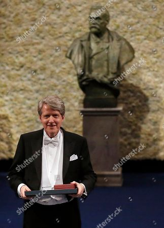 The 2013 Nobel Prize Laureate in Economic Sciences Robert J. Shiller of the US after receiving his Nobel Prize from Sweden's King Carl XVI Gustaf, during the Nobel Prize award ceremony at the Stockholm Concert Hall in Stockholm, . The Nobel awards are always awarded on Dec. 10, the anniversary of Alfred Nobel's death in 1896. The prizes for laureates in medicine, chemistry, physics, economics and literature are awarded in the Swedish capital Stockholm, whilst the Nobel Peace Prize is awarded on the same day in Oslo, Norway