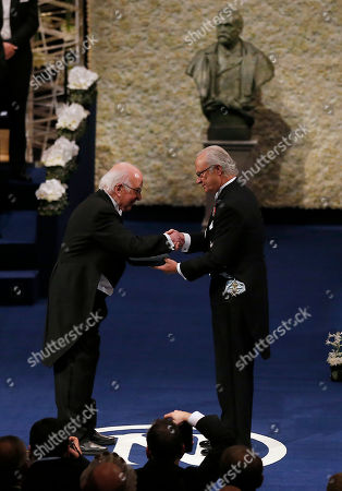 The 2013 Nobel Prize Laureate in Physics, Britain's Peter Higgs, receives his Nobel Prize from Sweden's King Carl XVI Gustaf, during the Nobel Prize award ceremony at the Stockholm Concert Hall in Stockholm, . The Nobel awards are always awarded on Dec. 10, the anniversary of Alfred Nobel's death in 1896. The prizes for laureates in medicine, chemistry, physics and literature are awarded in the Swedish capital Stockholm, whilst the Nobel Peace Prize is awarded on the same day in Oslo, Norway