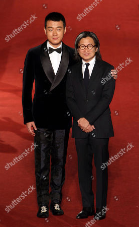 """Tong Dawei, Peter Chan Chinese Actor Tong Dawei, left, and hong kong director Peter Chan arrive at the 50th Golden Horse Awards in Taipei, Taiwan, . Tong is nominated as Best Supporting Actor for the film """"American Dreams In China"""" at this year's Golden Horse Awards -one of the Chinese-language film industry's biggest annual events"""