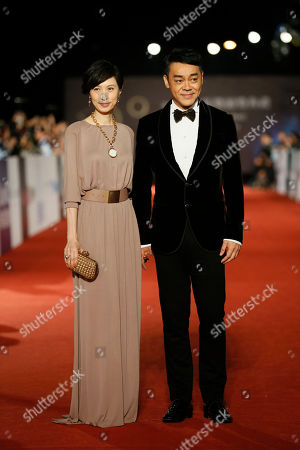 Sean Lau, Amy Kwok Hong Kong actor Sean Lau and his wife Amy Kwok pose on the red carpet at the 50th Golden Horse Awards in Taipei, Taiwan, . They are guests at this year's Golden Horse Awards, one of the Chinese-language film industry's biggest annual events