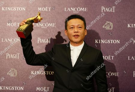 """Lee Kang Sheng Best Leading Actor Lee Kang Sheng holds his award for his film """" Stray Dogs """" at the 50th Golden Horse Awards in Taipei, Taiwan, . The Golden Horse Awards is the Chinese-language film industry's biggest annual events"""