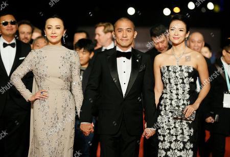 """Tony Leung Chiu Wai, Carina Lau, Zhang Ziyi Hong Kong actor Tony Leung, middle, poses with his wife Carina Lau, left and Chinese actress Zhang Ziyi arrive at the 50th Golden Horse Awards in Taipei, Taiwan, . Leung is nominated as Best Leading Actor for the film """" The Grandmaster"""" at this year's Golden Horse Awards -one of the Chinese-language film industry's biggest annual events"""