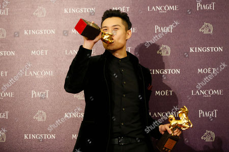 "Anthony Chen Singapore director Anthony Chen kisses one of his awards, and poses for the media, after winning the Best New Director and the Best Original Screenplay awards, at the 50th Golden Horse Awards in Taipei, Taiwan, . Chen won for the film "" Ilo.Ilo "" at this year's Golden Horse Awards -the Chinese-language film industry's biggest annual events"