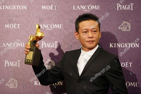 """Lee Kang Sheng Best Leading Actor Taiwan's Lee Kang Sheng holds his award for his film """" Stray Dogs """" at the 50th Golden Horse Awards in Taipei, Taiwan, . The Golden Horse Awards is the Chinese-language film industry's biggest annual events"""