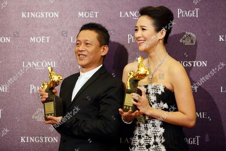 """Lee Kang Sheng, Zhang Ziyi Best Leading Actor Lee Kang Sheng, left, and actress Zhang Ziyi hold their awards for their film """" Stray Dogs """" and """" The Grandmaster """"at the 50th Golden Horse Awards in Taipei, Taiwan, . The Golden Horse Awards is the Chinese-language film industry's biggest annual events"""