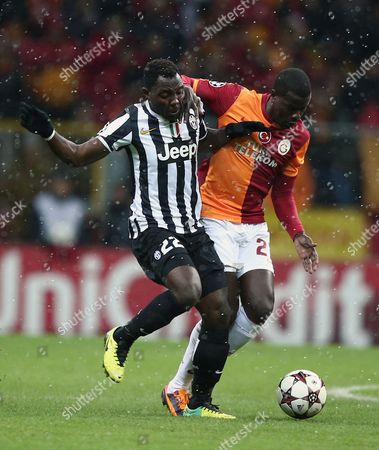 Kwadwo Asamoah, Emmanuel Eboue Galatasaray's Emmanuel Eboue, right, and Kwadwo Asamoah of Juventus fight for the ball during their Champions League soccer match at the TT Arena Stadium in Istanbul, Turkey