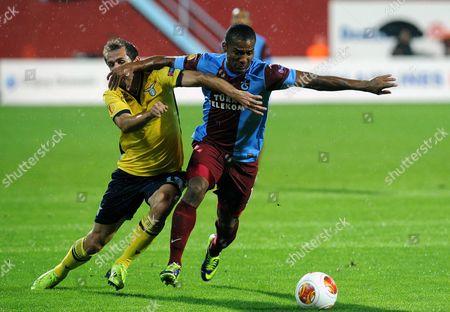 Senad Lulic, Florent Malouda Senad Lulic of Lazio, left, and Florent Malouda of Trabzonspor clash during their Europa League soccer match in Trabzon, Turkey