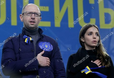 Arseniy Yatsenyuk, Eugenia Tymoshenko Ukrainian opposition leader Arseniy Yatsenyuk, left, and Eugenia Tymoshenko daughter of jailed former Ukrainian Prime Minister, Yulia Tymoshenko sing the anthem during a protest in Kiev, Ukraine, . Tens of thousands of demonstrators marched through central Kiev on Sunday to demand that the Ukrainian government reverse course and sign a landmark agreement with the European Union in defiance of Russia. The protest was the biggest Ukraine has seen since the peaceful 2004 Orange Revolution, which overturned a fraudulent presidential election result and brought a Western-leaning government to power