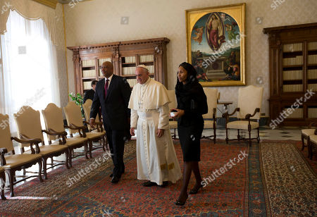 Pope Francis center, walks with King Letsie III of Lesotho, left, and his wife Queen Masenate Mohato, on the occasion of their private audience at the Vatican