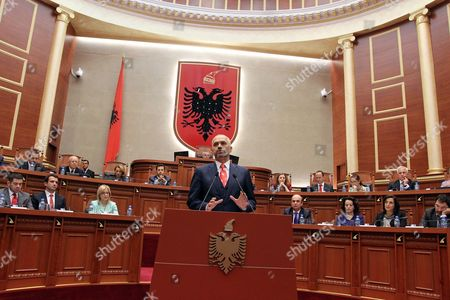 Albania-New Government Albania's new Socialist Prime Minister Edi Rama speaks in Parliament after lawmakers voted 82-55 to approve the 20-member Cabinet. Rama's Socialist-led leftist coalition won a landslide election victory in June 2013, defeating former conservative Prime Minister Sali Berisha on pledges of fighting widespread corruption and bringing the NATO member closer to its goal of joining the European Union