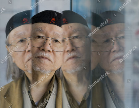 Leiji Matsumoto AP10ThingsToSee - Manga artist Leiji Matsumoto is reflected on glass panels as he poses for portraits at the 70th edition of the Venice Film Festival in Venice, Italy