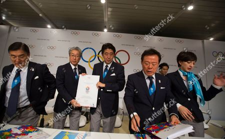 Left to right, Japanese Olympic Committee Vice President Masato Mizuno, Tokyo 2020 Olympic Bid Committee President Tsunekazu Takeda, Japan's Prime Minister Shinzo Abe, Governor of Tokyo and Chairman of Tokyo 2020, Naoki Inose and Cool Tokyo Ambassador for Olympic bid Christel Takigawa, pose for a photo after a news conference in Buenos Aires, Argentina, . During the Sept. 4-10 IOC meeting, members will elect the host city for the Summer Olympics Games of 2020, with candidates being Madrid, Istanbul and Tokyo, as well as choose a new IOC president and add a sport to the 2020 program
