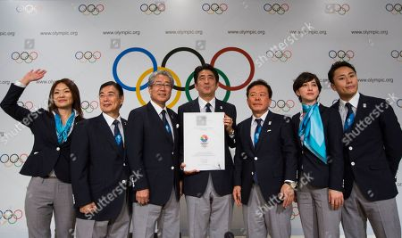 Left to right, Japanese Paralympian Mami Sato, Japanese Olympic Committee Vice President Masato Mizuno, Tokyo 2020 Olympic Bid Committee President Tsunekazu Takeda, Japan's Prime Minister Shinzo Abe, Governor of Tokyo and Chairman of Tokyo 2020, Naoki Inose, Tokyo Ambassador for Olympic bid Christel Takigawa, and Japanese Olympian Yuki Ota, pose for a photo after a news conference in Buenos Aires, Argentina, . During the Sept. 4-10 IOC meeting, members will elect the host city for the Summer Olympics Games of 2020, with candidates being Madrid, Istanbul and Tokyo, as well as choose a new IOC president and add a sport to the 2020 program