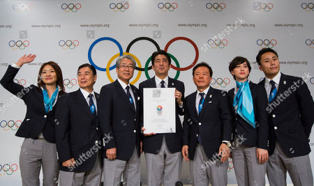 Left to right, Japanese Paralympian Mami Sato, Japanese Olympic Committee Vice President Masato Mizuno, Tokyo 2020 Olympic Bid Committee President Tsunekazu Takeda, Japan's Prime Minister Shinzo Abe, Governor of Tokyo and Chairman of Tokyo 2020, Naoki Inose, Cool Tokyo Ambassador for Olympic bid Christel Takigawa, and Japanese Olympian Yuki Ota, pose for a photo after a news conference in Buenos Aires, Argentina