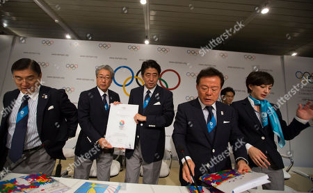 Left to right, Japanese Olympic Committee Vice President Masato Mizuno, Tokyo 2020 Olympic Bid Committee President Tsunekazu Takeda, Japan's Prime Minister Shinzo Abe, Governor of Tokyo and Chairman of Tokyo 2020, Naoki Inose and Cool Tokyo Ambassador for Olympic bid Christel Takigawa, pose for a photo after a news conference in Buenos Aires, Argentina