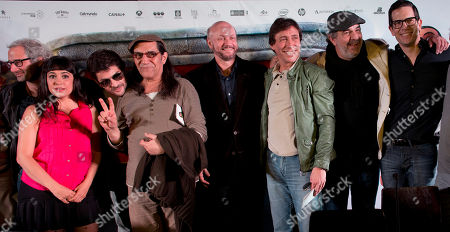 """Juan Jose Campanella, Diego Ramos, Miguel Angel Rodriguez, Horacio Fontova, Pablo Rago, Lucia Maciel,David Masajnik, Fabian Gianola Oscar winning director Juan Jose Campanella, center, poses for a photo with actors providing the voices for characters in """"Metegol,"""" from left to right; David Masajnik as Amadeo, Lucia Maciel as Laura, Pablo Rago as Capi, Horacio Fontova as Loco, Fabian Gianola as Beto, Miguel Angel Rodriguez as Liso and Diego Ramos as Grosso, in Buenos Aires, Argentina, . Campanella, who was awarded an Oscar for """"The Secret in their Eyes,"""" in the best foreign language film category, will premiere his 3D animated movie in Argentina, July 18"""
