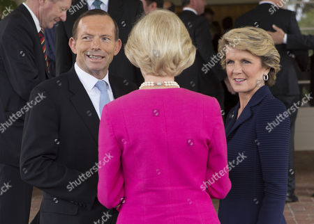 Tony Abbott, Julie Bishop, Quentin Bryce Tony Abbott, left, talks with Foreign Minister Julie Bishop, right, and Governor General Quentin Bryce, center, after being sworn in as the 28th prime minister of Australia at Government House in Canberra . Abbott promised immediate action to slow the stream of asylum seekers arriving by boats from Indonesia and to repeal an unpopular carbon tax levied by the previous administration