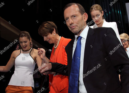 """Tony Abbott, Frances Abbott, Margie Abbott, Bridget Abbott Australian opposition leader Tony Abbott leaves the stage with his family, from left, his daughter Frances, his wife Margie and his daughter Bridget, during the coalition campaign launch in Brisbane, Australia. Abbott, the political pugilist who leads Australia's opposition, was once dubbed """"unelectable"""" by a former boss, but as the Sept. 7 elections near he seems certain to become prime minister. The 55-year-old conservative has never been very popular. His Liberal Party colleagues elected him their leader by just a single vote in 2009. """"Polarizing"""" is an adjective often used to describe him"""