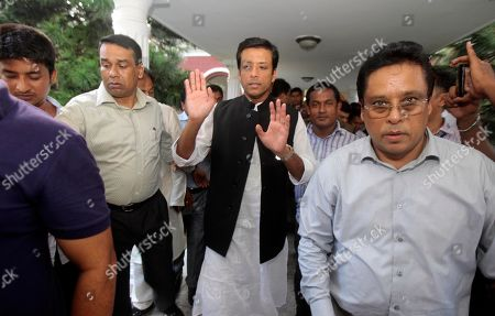 Sajeeb Wazed Joy, center, the son of Bangladeshi Prime Minister Sheikh Hasina, walks towards an election campaign rally in Mymensingh, near Dhaka, Bangladesh. Political observers in Bangladesh said that given a few years Joy or Tarique Rahman, the 45-year-old son of opposition leader Khaleda Zia, could become prime minister of Bangladesh, which has been ruled by their two families since the country's 1971 independence from Pakistan. Joy and Rahman have emerged as the country's most powerful political heirs