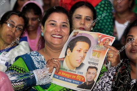 A Bangladesh Awami League woman supporter holds a poster of Sajeeb Wazed Joy, 42, the son of Prime Minister Sheikh Hasina, at an election campaign rally in Mymensingh, near Dhaka, Bangladesh. Political observers in Bangladesh say that given a few years Joy or Tarique Rahman, the 45-year-old son of opposition leader Khaleda Zia, could become prime minister of Bangladesh, which has been ruled by their two families since the country's 1971 independence from Pakistan. Joy and Rahman have emerged as the country's most powerful political heirs