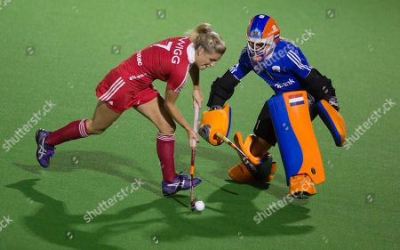 Joyce Sombroek, Georgie Twigg Netherland's goaltender Joyce Sombroek, right, defends against England's Georgie Twigg during a tie-break penalty shootout at a women's semi-final Eurocup field hockey match at the Braxgata Hockey Club, in Boom, Belgium on