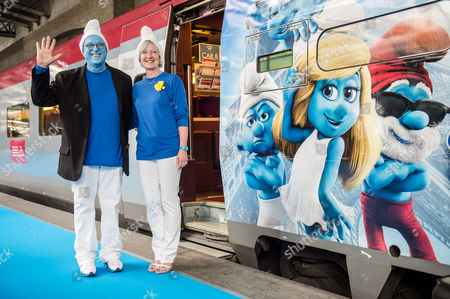 """Jordan Kerner, Veronique Culliford U.S. film producer of the Smurfs 2 movie Jordan Kerner, left, and the daughter of Smurfs creator Peyo, Veronique Culliford, pose for photographers as they are ready to board a Smurfs Thalys train to Paris during the Global Smurfs Day gathering in Brussels, . The celebration honors Smurfs creator Pierre """"Peyo"""" Culliford's June 25 birthday and the opening of movie 'The Smurfs 2' on July 31"""