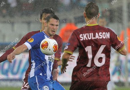 Nick Powell, Olafur Skulason Wigan Athletic Nick Powell, left, challenges Zulte-Waregem Olafur Skulason, during the Europa League group stages in group D, at the Jan Breydel stadium in Bruges, Belgium