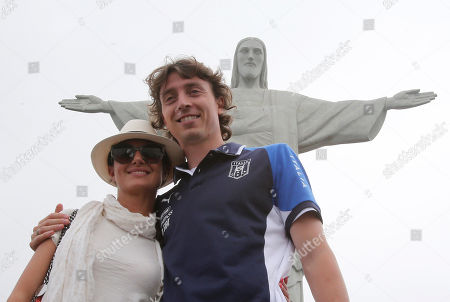 Italy midfielder Riccardo Montolivo poses with his partner Cristina de Pin as the Italian team visit the Christ the redeemer statue on Corcovado mountain at the soccer Confederations Cup in Rio de Janeiro, Brazil