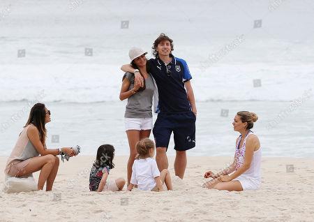 Italy midfielder Riccardo Montolivo, center, right, relaxes on the beach with his girlfriend Cristina de Pin at the soccer Confederations Cup in Rio de Janeiro, Brazil