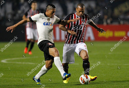 Luis Fabiano, Ralf Luis Fabiano, right, of Brazil's Sao Paulo FC fights for a ball with Ralf of Brazil's Corinthians during the Recopa Sudamericana final soccer match in Sao Paulo, Brazil