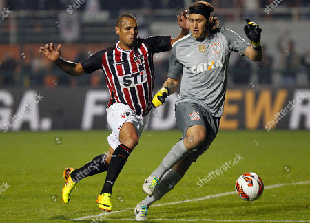 Luis Fabiano, Cassio Luis Fabiano of Brazil's Sao Paulo FC, left, fights for a ball with goalkeeper Cassio of Brazil's Corinthians during the Recopa Sudamericana final soccer match in Sao Paulo, Brazil