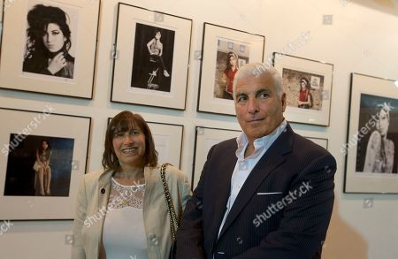 Stock Picture of Janice and Mitch Winehouse mother and father of the late British singer Amy pose for the media, in front of portraits of their daughter at the Proud gallery in Camden, London, Wednesday, Sept.11, 2013. In the month she would have turned 30, Amy Winehouse is being celebrated in Camden the London neighbourhood that was her physical and spiritual home, she died of accidental alcohol poisoning at her house in July 2011, aged 27. The neighbourhood still attracts her fans, and local officials and businesses are holding a series of September events to raise money for the Amy Winehouse Foundation, a youth charity established by the singer's family