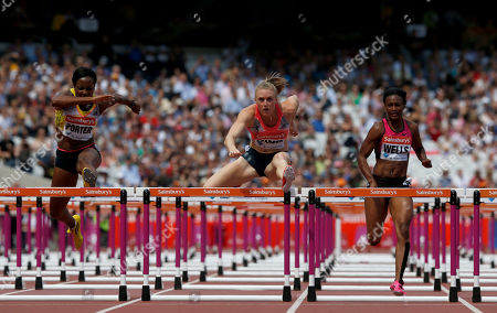 Stock Picture of Australia's Sally Pearson, center, finishes in first place ahead of Britain's Tiffany Porter, left, and Kellie Wells, right, from the U.S. during the women's 100m hurdles race at the Diamond League athletics meet at the Stadium in the Queen Elizabeth Olympic Park, London, . The athletics meet marks the anniversary of the London 2012 Olympic Games