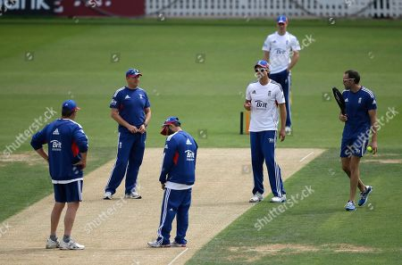 England's cricket captain Alastair Cook, second right, talks to team coach Andy Flower, second left, during a nets session for the 5th Ashes cricket Test against Australia, at the Oval cricket ground in London, . The 5th test starts Wednesday at the Oval in London, England have already won the series and retained the Ashes